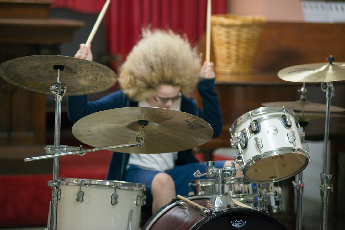 Pic of Drum Lesson Student Rocking Out